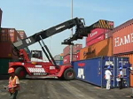 Crane moving a container